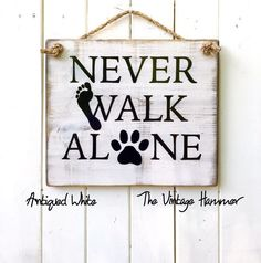 Dog parents know that you will NEVER WALK ALONE when you have the love of your dog. Get this sign today in 16 different color choices! Exclusively at THE VINTAGE HAMMER