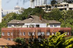 The penthouse at Princeton in Double Bay was the home of interior designer Leslie Walford from 1975 until his death in 2012. Although situated on the top floor, the penthouse actually resembles a small bungalow placed atop the 1939 apartment block. An outdoor terrace wraps around the whole apartment and the front rooms enjoy views north across Sydney Harbour.