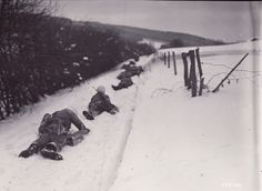 16 DEC 1944 - The beginning of the Battle of the Bulge; 2nd Infantry Division combat patrol members lie flat on the ground to escape enemy fire near Odenval, Belgium. G Company, 23rd Regiment. Photo courtesy of the National Archives.