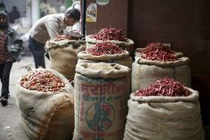 As you walk through the bustling markets in Delhi, the air has a spice to it thanks to the bushels of dried chili peppers. It's enough to make your eyes water. | Traveling Through India (With Kids!)