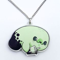 Kawaii necklace featuring our bubble tea manatee in honeydew flavor!