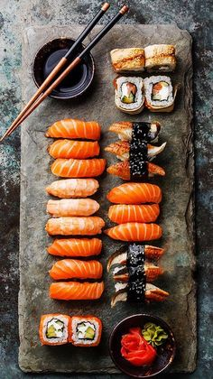Sushi Set sashimi and sushi rolls served on stone slate- dinner- Japanese food Sushi Set, Sushi Party, I Love Food, Good Food, Yummy Food, Sushi Comida, Sushi Food, Japanese Food Sushi, Sushi Dishes