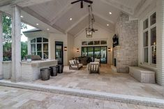 White plank vaulted patio with pavers. Neutrals are always a good idea when designing a cottage-style patio. White plank vaulted patio with pavers. Neutrals are always a good idea when designing a cottage-style patio. Outdoor Kitchen Patio, Casa Patio, Outdoor Rooms, Deck Patio, Covered Patio Kitchen Ideas, Patio With Pavers, Outdoor Fireplace Patio, Outdoor Living Patios, Outdoor Fireplaces