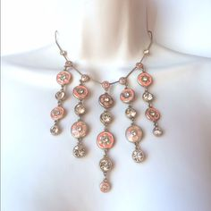 NWT Pilgrim Necklace Signature peach color flowers and stones gathered on a gold tone chain. Approximately 14 inches long with an adjustable 3 inch extender. No trades. Generous discount with bundle. Pilgrim Jewelry Necklaces