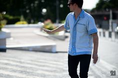 Man wearing blue shirt with short sleeves