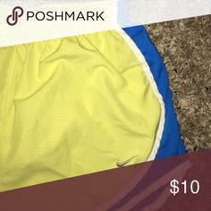 Yellow Nike shorts Shorts in great shape. Initials are written on the inside but not noticeable when worn. Nike Shorts