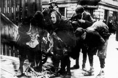 Warsaw, Poland, Children caught smuggling by German policemen.  Their punishment was always a German bullet in the head.