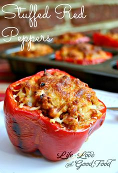 Healthier version Stuffed Red Peppers - made with a combination of lean ground turkey and sausage, onion, cheese, and Italian spices