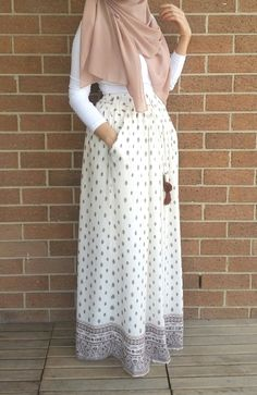 Pinterest: @eighthhorcruxx. White top, white patterned maxi skirt and hijab