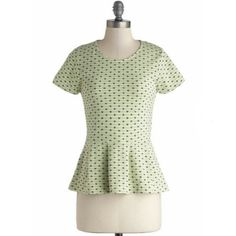 ModCloth: Quay Lime Pie Top Take in a waterfront sweet treat with your coworkers in this adorable heart-printed peplum top. With its soft green hue, blue pattern, knit composition, and striped lining, this short-sleeved shirt adds darling detail to skinny trousers and pointed patent flats. Pull your sunnies from your navy tote and relax during your riverside lunch hour - you've earned it! ModCloth Tops