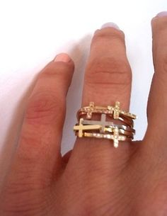 Sideways cross gold rings