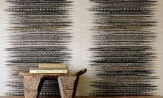 An embossed, wide, multicoloured raffia grass-cloth, with an artisan naturalness.
