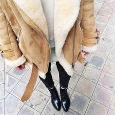 Shearling fur coat + black jeans + booties.