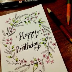 Hand drawn birthday card.  Happy birthday typography with flower & leaf details