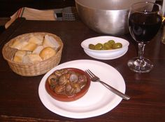 Escargot cooked in red wine and spices, served with olives and bread with a Rioja......Cordoba, Spain 2011