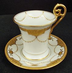 This pair of porcelain chocolate cups and saucers was produced in France by Tressemann & Vogt Limoges in the late century. The saucers have a diameter of 4 inches and the cup is 3 inches high Tea Cup Saucer, Tea Cups, Breakfast Cups, Chocolate Cups, Teapots And Cups, Vintage Cups, Tea Art, My Cup Of Tea, Vintage Tea
