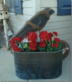 Old Boiler Pan...with a prim crow and red geraniums.