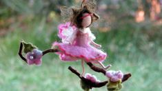 Ready to ship  I just love to combine wool with nature. These little fairies ornaments are my favorite creations. Each of them has its own personality, there can not be two the same.  This little fairy ( the fairy is about 13 cm, 5.5) is swinging on a twig. The twig is decorated with flowers and leaves. She is made in shades of pink and has silky wings.  A little addition of magic. I love to give them as presents for my friends and their children. They are needle felted, Waldorf inspired…