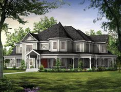 A magnificent, finely wrought covered porch wraps around this impressive Victorian estate home. Victorian House Plan # 741009.