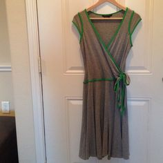 BCBG faux wrap dress Very flattering stretchy jersey faux wrap dress from BCBG with bow detail and bright green piping. Would also fit a size small. BCBGMaxAzria Dresses