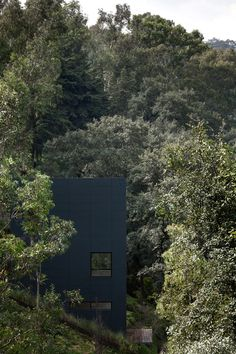 This stacked module house with a perforated facade of a digitalized tree was built as a weekend house on a steep slope with majestic views of the valley.