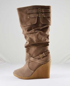 """Fashionable suede boot enhanced with two buckle closures on top and one extra at the bottom. Featured round toe and rubber wedge heel to add some extra comfort. Internal side zipper closure for easy in and out.  Run true to size.  Platform: 0.5""""  Heel height: 4""""   Shaft length: 15"""" (including heel)  Top opening circumference: 15"""" aprox.  All Man Made Material.   Imported.   $56.00"""