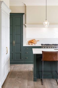 We love how this stylish kitchen came together. Our in-frame shaker cabinetry is painted in studio green by and finished… We love how this stylish kitchen came together. Our in-frame shaker cabinetry is painted in studio green by and finished… Stylish Kitchen, New Kitchen, Kitchen Dining, Kitchen Ideas, Country Kitchen, Modern Shaker Kitchen, Funky Kitchen, Shaker Style Kitchens, Studio Kitchen