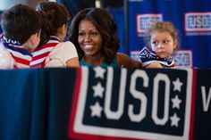 First Lady Michelle Obama and some little supporters.