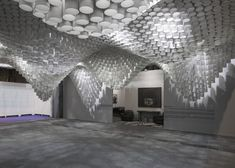 An undulating canopy of cardboard tubes by American studio Cristina Parreño Architecture and students from MIT
