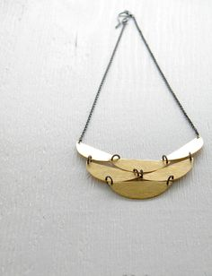 "One please!!!!!!!  Gorgeous with alibli's typical attention to detail and unique voice. These pieces could honestly go for 4 or 5 times their price on Etsy. Get them before they are hot or I'll have to say,"" Told ya so!"" Half Moon Cascade  statement bold tribal necklace  Brass by alibli, $44.00"