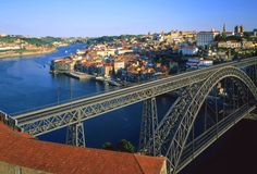 Ponte de Dom Luís I - Porto, Portugal;  over the Douro River;  the engineer had worked as an associate of Gustave Eiffel on the Maria Pia Bridge, and was given the goal of making this bridge even more grand than the Eiffel Tower;  the arch is 545 feet long and 146 feet high;  the lower carriageway is suspended on the bridge, and the upper track over the arch is used by Porto's metro;  photo by Bildagentur Huber/Giovanni