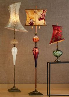 Mixed-media lamps by Caryn Kinzig and Susan Kinzig . Wasn't sure if I should put in Glorious hats or one my art pins!