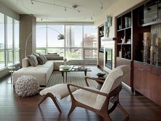 Love the vintage chair, the sofa, the light, the windows...