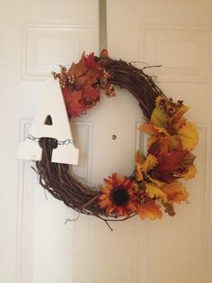 Fall wreath. I'd want the letter to stand out from the door more tho. Should've picked a different color.