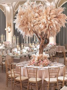 Luxe Bohemian Wedding at the Beverly Hills Hotel. Floral Design by Empty Vase Florist – Pillar Candles İdeas. Beverly Hills Hotel, The Beverly, Design Floral, Floral Centerpieces, Tree Centrepiece Wedding, Ostrich Feather Centerpieces, Tall Wedding Centerpieces, Wedding Table, Decor Wedding