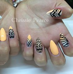 More tribal design inspired abstract nail art. The black patterns drawn on top of the baby blue and yellow gradient contrasts beautifully and makes the design stand out even more.