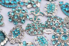 10pc Tiffany Blue Teal Assorted Rhinestone Flat back Embellishments DIY Brooches Crystal Buttons Wedding Bouquet Favors Invitations Bling. $17.50, via Etsy.