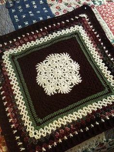 """One of my favorite squares and I love the center design!  Making this about 25"""" give or take to use as the center for my Christmas afghan.  I added: Hdc - green Sc - burgundy Hdc - green V st..."""