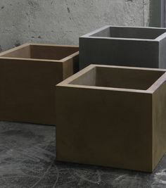 Basic is a series of planters in concrete, available in gray or brown color length 220 mm width 220 mm 120/180/240 height mm  Design Stina Lindholm.