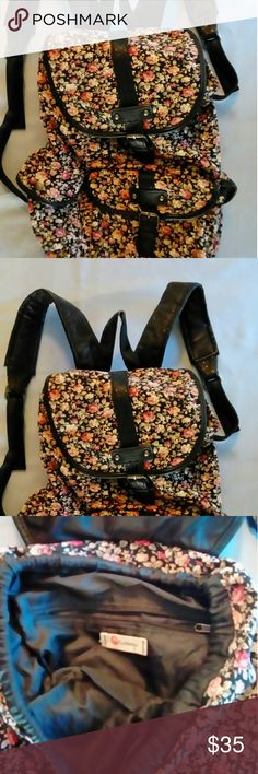 """Olsenboye floral print backpack, like new! Olsenboye Floral Disty Print Backpack  Freshen up your studious looks with the darling floral  print on a roomy canvas backpack.?Designed with lots of pockets, it's perfect for action-packed days or overnight adventures.  adjustable backpack straps  top grab handle, 3"""" drop  foldover top flap with magnetic snap closure and drawstring  cotton with synthetic trim; polyester lining  bronze-tone metal decorative buckles  interior zipper pocket and 2…"""