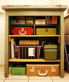 love the use of vintage luggage for organization @Leigh-Ann Keffer