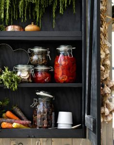 KROKEN glass jars shown inside OLOFSTORP wall cabinet
