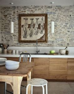 Eclectic Kitchen With Stone Wall