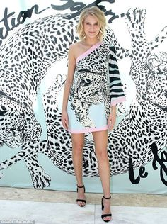 Stylish: Celina donned a patterned off-shoulder minidress with monochrome leopard-print