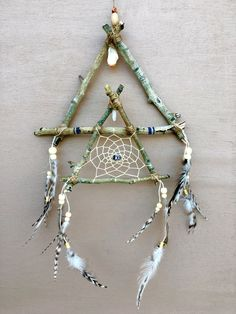 A personal favorite from my Etsy shop https://www.etsy.com/listing/508461185/double-triangle-natural-dream-catcher