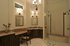 Warm up your master bathroom with darker colors.