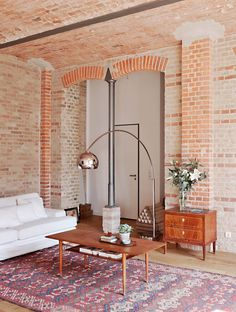 If you're looking for decorating ideas with exposed brick walls. Here it is. This home is the perfect example of how to decorate with exposed brick walls.