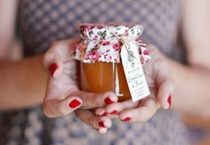 Small jars of homemade Peach Jam as wedding / party gifts.
