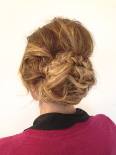 Loose undone up-do with hight and a braid detail.