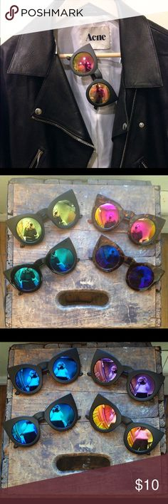 NWT OVERSIZED MIRRORED CAT EYE SUNGLASSES Oversized black mirrored cat eye sunglasses. Big cateye sunglasses with revo rainbow mirrored lenses. 100% UVA/UVB protection. All colors available!  ❌ NO offers accepted for items $10 and under. ❌ NO trades ❌ NO try-ons  ✅ YES Bundles ✅ Yes Offers on items above $10 AND bundles! Accessories Sunglasses